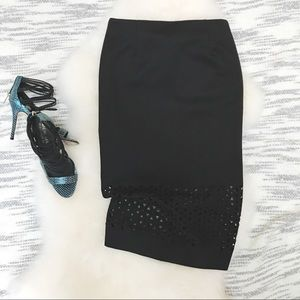 Black pencil skirt with laser cutouts